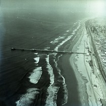 Aerial view of beach and pier, Huntington Beach, California: Photograph