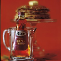 A bottle of Diet Delight maple syrup in a pitcher