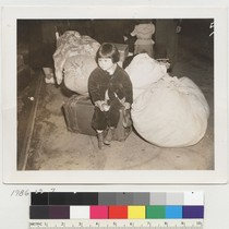 [Child with luggage]