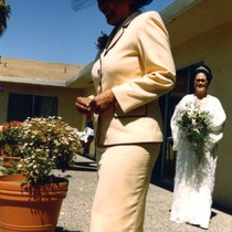 Patricia Whiting following her sister Elyse down the aisle