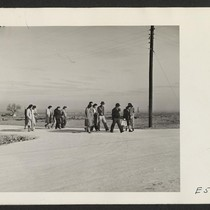 5:00 P.M. and the administrative office workers trek home to their barracks. ...