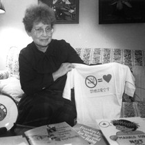 Donna Shimp holding tobacco control t-shirt