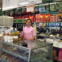 Store clerk and merchandise at a Vietnamese shop, Van's Bakery, in the ...