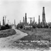 Oil derricks in Huntington Beach, California: Photograph