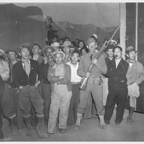 Manzanar, Calif.--While military policeman stands guard, this detachment watches arrival of evacuees ...