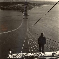 Footbridge ropes stretch across the Golden Gate during the construction of the ...