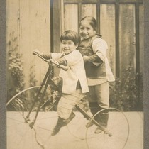 [Unidentified children on bicycle.]