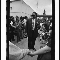 African American man speaking to an audience, Los Angeles, 1999