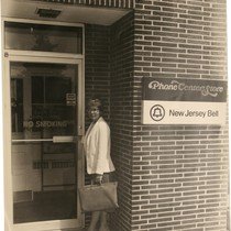 Donna Shimp at entrance of Phone Center Store New Jersey Bell