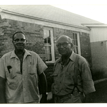 Herman Bousley and William Watts standing out of C.M.E. church, Lodi, Texas