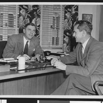 alumni review editor Arnold Eddy (left) and University of Southern California coach ...