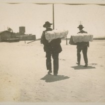 """Blanket Stiffs"". [Two men carrying bedrolls on their backs.]"