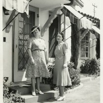 1940, Two Library Staff Pose in Front of a Bungalow