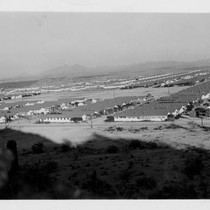 Aerial view of Gila River Relocation Center with mountains in background