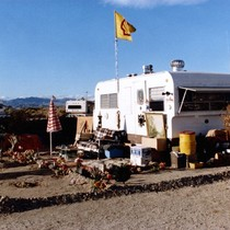 Slab City: photograph of trailer home with garden