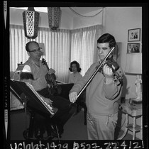 15 year old violinist Glenn Dicterow rehearsing with his parents Harold and ...