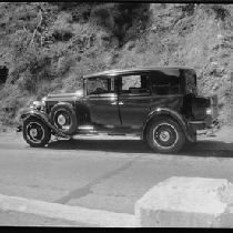 Automobile parked on roadside next to embankment