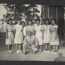 [Japanese-American soldier with a group of young women]