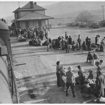 Evacuees of Japanese ancestry waiting to board buses which will take them ...