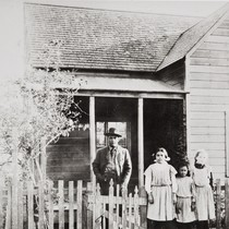 Albert Leiva and the Barrios children in front of their parents' home ...