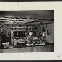 The kitchen section at work preparing dinner for Block 7, in the ...