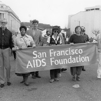 People marching with San Francisco AIDS Foundation banner in Martin Luther King ...
