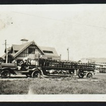 1912 Seagrave tractor and American-La France trailer in front of Station No. ...