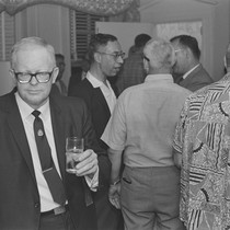 Alva Rogers, Donald A. Wollheim in right profile, with fans, BayCon
