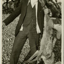 G. Tomilson (?) and coyote, c. 1920s