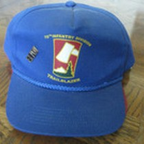 A Blue Baseball Cap With the inscription 70Th infantry Division Trailblazer and ...