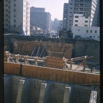 Construction of freeway, probably the Harbor Freeway