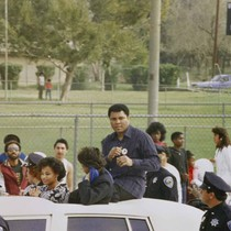 Muhammad Ali participates in San Bernardino's Black History Parade, [graphic]