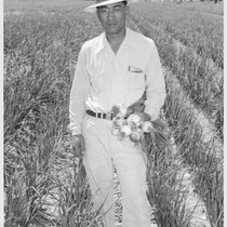 Henry Inouye, evacuee supervisor of the Granada Relocation Center farm, and a ...
