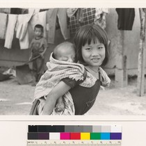 Hmong girl and sleeping sibling
