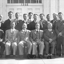 18 men in front of the KNA Building