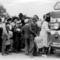 Members of farm families board evacuation buses. Evacuees of Japanese ancestry will ...