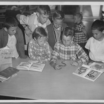Boys learning about snakes at Santa Clara Public Library, 1958