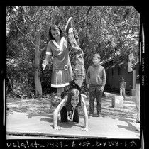 1956 Olympic gold medalist Olga Connolly-Fikotova playing with children at UCLA elementary ...