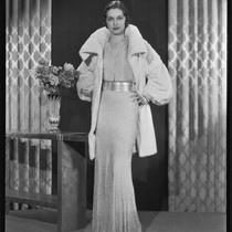 Actress Gail Patrick modeling a white Russian ermine coat, 1933