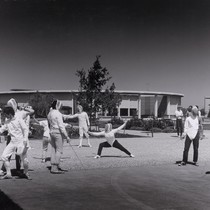 Photograph of a fencing class or club practicing in front of the ...