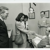 John C. Greene, Nancy Pelosi, and Deborah Greenspan visit dentist and patient