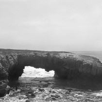 An arch, from which the sandstone has worn from underneath
