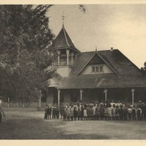 1920's postcard, student's in front of school