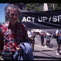 John S. James in front of ACT UP San Francisco banner at ...
