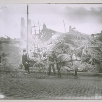 Horse and buggy with men and woman in front of ruins