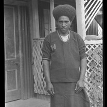 Ahuia, one of Lambert's Motu assistants, wearing uniform with H, standing for ...