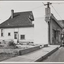 Bakery and laundry near storefront of old residence, south side of West ...