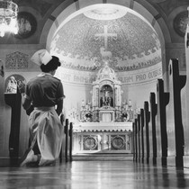 Nursing student praying in St. Joseph's Hospital Chapel