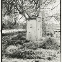 Outhouse in field