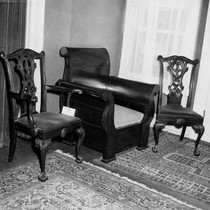 2 chippendale-ish chairs by a big wooden chair